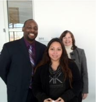EEOC Trial Attorney Richard Sexton, Belinda Murillo (Center), EEOC Trial Attorney Nancy Griffiths