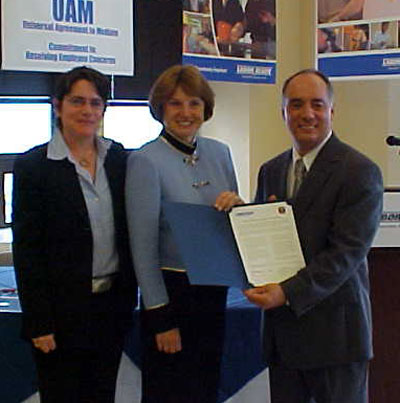 EEOC Chair Cari M. Dominguez with Labor Ready, Inc. CEO Joe Sambataro and EEOC Attorney-Mediator Nancy Maisano