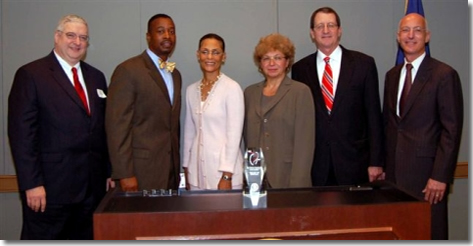 <em>From left to right: Albert K. Blackwelder of Emory Crawford Long Hospital, Anthony L. Burfoot,<br>  Vice Mayor of The City of Norfolk, Chair Earp, Francine M. Tishman of Abilities, Inc., Ronald R. <br> Peterson of Johns Hopkins Health System, Richard J. Morgante of the IRS.</em