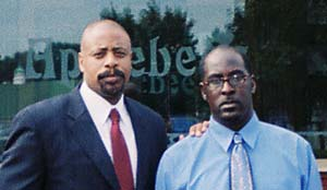 Charging Party Dwight Burch (right) is pictured in front of Applebee's with EEOC Atlanta Regional Attorney Robert Roya