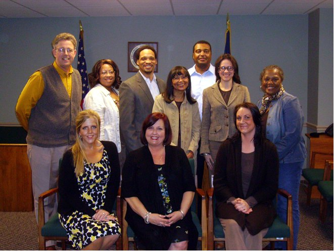 Front row seated:  Karen Wingate, Sandra Williamson, and Jennifer Looney, Claimants. Second Row:  Attorney Joseph Crout, Paralegal Tralia Rahmaan, Lead Attorney Kenneth Anderson, Supervisory Trial Attorney Deidre Smith, Attorney Kelley Thomas, Paralegal Nancy Kincaide  Third Row:  Former Investigator Edmond Sims (District Resources Manager)